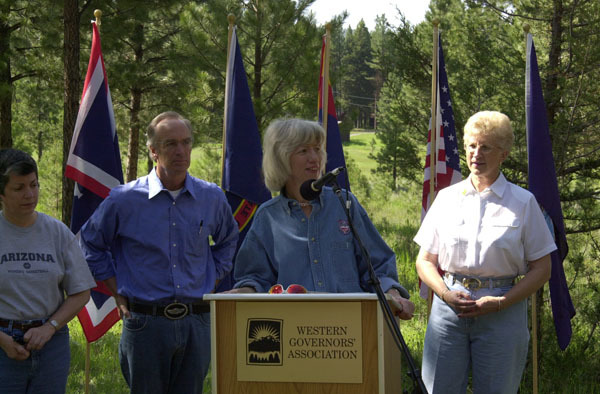 Arizona Governor Janet Napolitano, Idaho Governor Dirk Kempthorne, Secretary Gale Norton, and Montana Governor Judy Martz, left to right, during the Western Governors' Association Forest Health Summit in Missoula, Montana