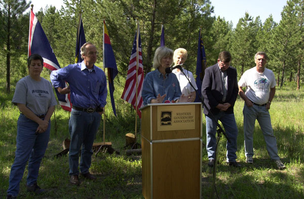 Arizona Governor Janet Napolitano, Idaho Governor Dirk Kempthorne, Secretary Gale Norton, Montana Governor Judy Martz, Wyoming Governor Dave Freudenthal, and Forest Service Chief Dale Bosworth, left to right, during the Western Governors' Association Forest Health Summit in Missoula, Montana