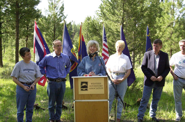 Arizona Governor Janet Napolitano, Idaho Governor Dirk Kempthorne, Secretary Gale Norton, Montana Governor Judy Martz, and Wyoming Governor Dave Freudenthal, left to right, at press conference during the Western Governors' Association Forest Health Summit in Missoula, Montana. Photograph was used in Interior video on Norton tenure
