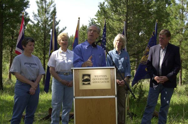Idaho Governor Dirk Kempthorne speaking, with Arizona Governor Janet Napolitano, Montana Governor Judy Martz, Secretary Gale Norton, and Wyoming Governor Dave Freudenthal behind, left to right, during the Western Governors' Association Forest Health Summit in Missoula, Montana