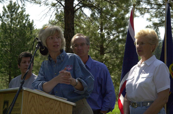 Secretary Gale Norton speaking, with Arizona Governor Janet Napolitano, Idaho Governor Dirk Kempthorne, and Montana Governor Judy Martz behind, left to right, during the Western Governors' Association Forest Health Summit in Missoula, Montana