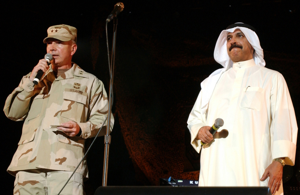 """US Army (USA) Major General (MGEN) William Webster, Commanding General (CG) of the Coalition Forces Land Component Command (CFLCC) and the Vice Emir of Kuwait, Sheik Saud Nasir Al-Saba, address a crowd during a United Service Organizations (USO) tour, """"Project Salute 2003,"""" which pays tribute to the men and women of the US and coalition armed forces"""