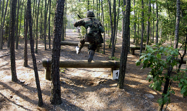 A US Army (USA) troop with Alpha Company, 3rd Battalion, 518th Infantry Regiment, makes his way through the bayonet course during Army Basic Training (ABT), at Fort Jackson, South Carolina (SC).Charlie Company 3rd Battallion, 13th Infantry Regiment