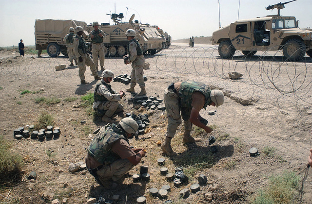 US Army (USA) Soldiers assigned to 3rd Infantry Division (Mechanized) remove Iraqi PMN Anti-Personnel (AP) mines found near Fallujah, Iraq, during Operation IRAQI FREEDOM