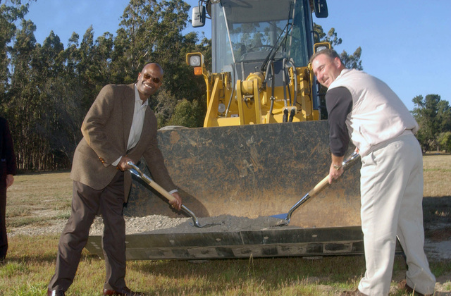 US Air Force (USAF) Colonel (COL) Edward Bolton, left and CHIEF MASTER Sergeant (CMSGT) Phillip Cope, with the 30th Operations Group (OG) during a groundbreaking ceremony shovel dirt from the scoop of a bulldozer at new recreation area on Vandenberg Air Force Base (AFB), California