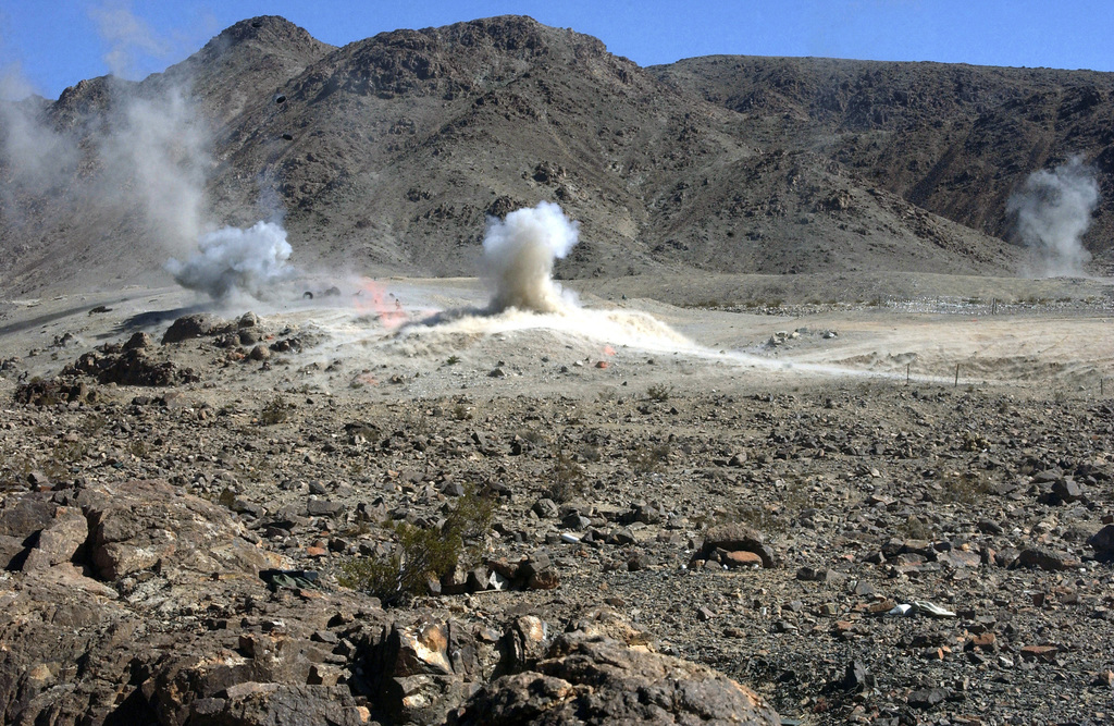A round from an AT-4 small rocket launcher impacts on Range 400 at Marine Air Ground Task Force Training Command (MAGTFTC), Twentynine Palms, California (CA)
