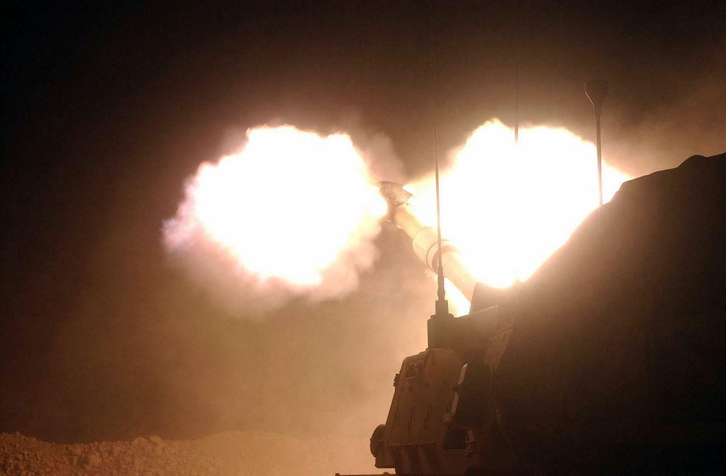 At Camp Warhorse in Diyala Province, Iraq (IRQ), a blast erupts from a 155mm, high explosive (HE) round fired from a M109A6, medium self-propelled Howitzer, 3rd Battalion, 16th Field Artillery (FA) (3/16th FA), 4th Infantry Division (ID), Fort Hood, Texas (TX), during Operation IRAQI FREEDOM