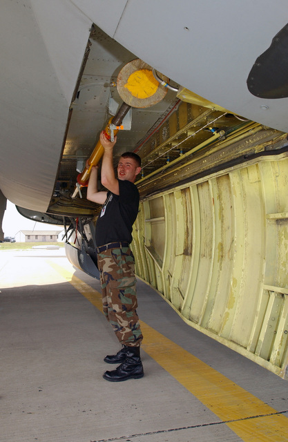 US Air Force (USAF) STAFF Sergeant (SSGT) Robert Scariano, with the 100th Aircraft Maintenance Squadron (AMXS), Royal Air Force (RAF) Mildenhall, England (ENG), stows a cargo loading strut under a KC-135R Stratotanker