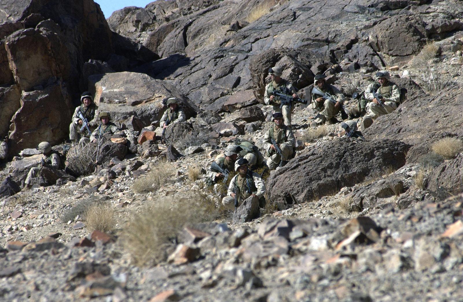 US Marine Corps (USMC) Marines from the First Platoon (Plt), Lima Company, 3rd Battalion, 4th Marines, take Machine Gun Hill at Range 400 at Marine Air Ground Task Force Training Command (MAGTFTC), Twentynine Palms, California (CA)