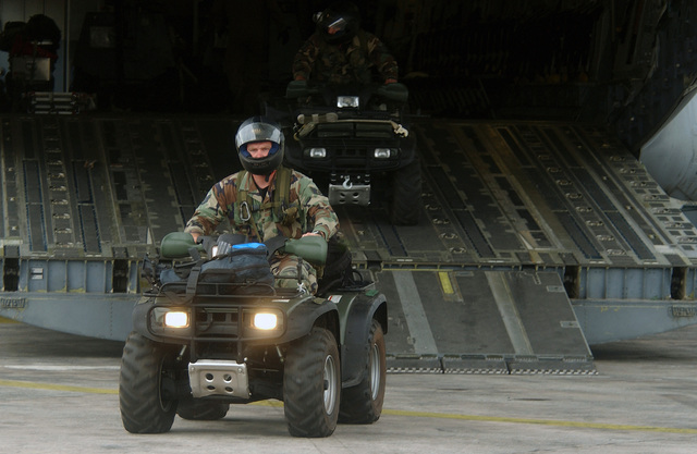 US Air Force (USAF) STAFF Sergeant (SSGT) Jon Harrison, an independent duty medical technician with the 786th Security Forces Squadron (SFS), Sembach Annex, Germany (DEU), drives an all terrain vehicle (ATV) from a C-17 Globemaster at Lungi, Sierra Leone, during a Humanitarian Assistance mission