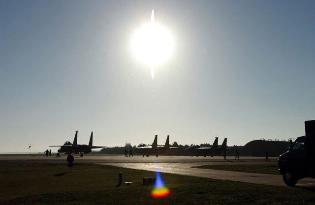 US Air Force (USAF) F-15E Strike Eagles wait at the end of a Royal Air Force (RAF) Lakenheath runway, before receiving permission to take off and deploy in support of Operation IRAQI FREEDOM