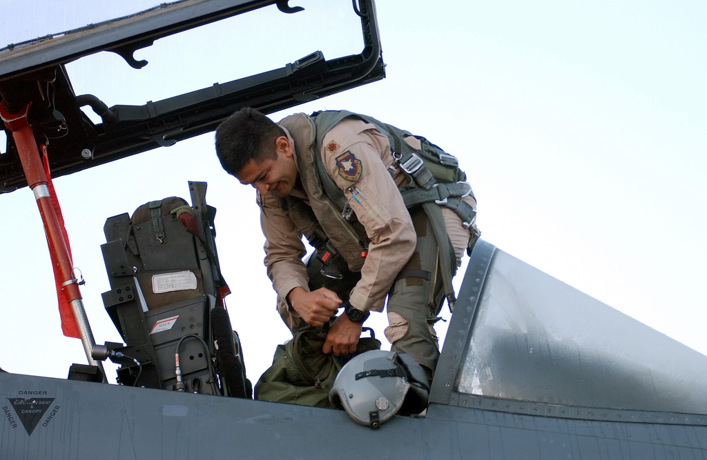 US Air Force (USAF) Major (MAJ) Om Prakash, a pilot from the 494th Fighter Squadron (FS), Royal Air Force (RAF) Lakenheath, England, stows his gear aboard his F-15E Strike Eagle before taking off on a deployment in support of Operation IRAQI FREEDOM