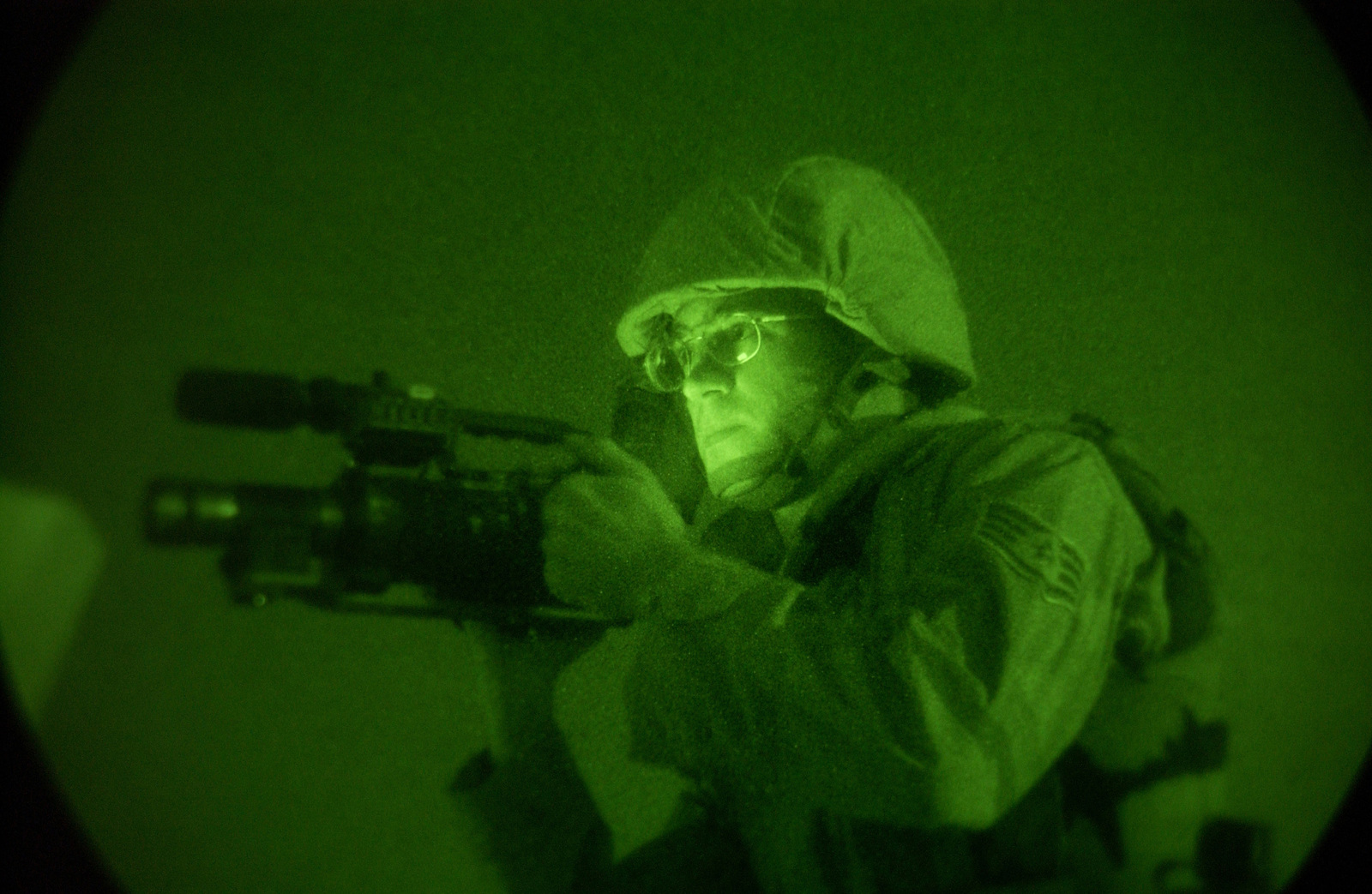 US Air Force (USAF) STAFF Sergeant (SSGT) Kevin Davidson, with the 506th Expeditionary Combat Camera (ECC) Detachment, records operations at Kirkuk Air Base (AB), Iraq, in support of Operation IRAQI FREEDOM