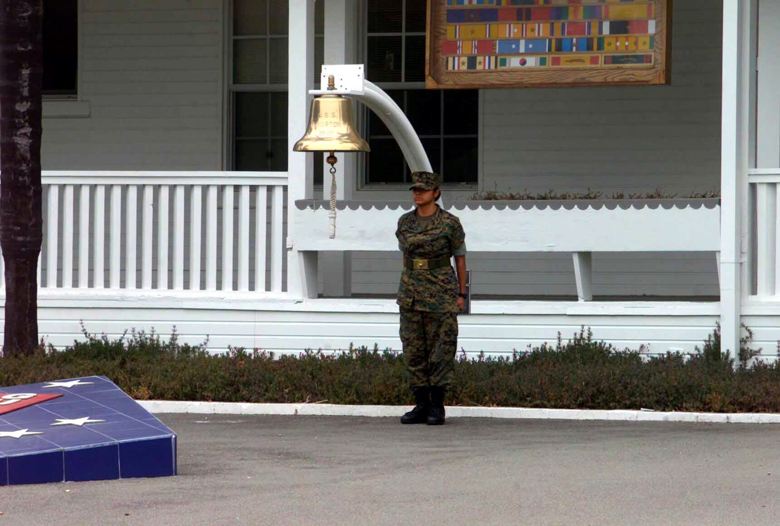 US Marine Corps (USMC) Marine Private First Class (PFC) Deosdady Andrade, Color Guard, 1ST Marine Division, Marine Corps Base (MCB) Camp Pendleton, California (CA), stands at the position of attention during morning colors at the 1ST Marine Division Headquarters