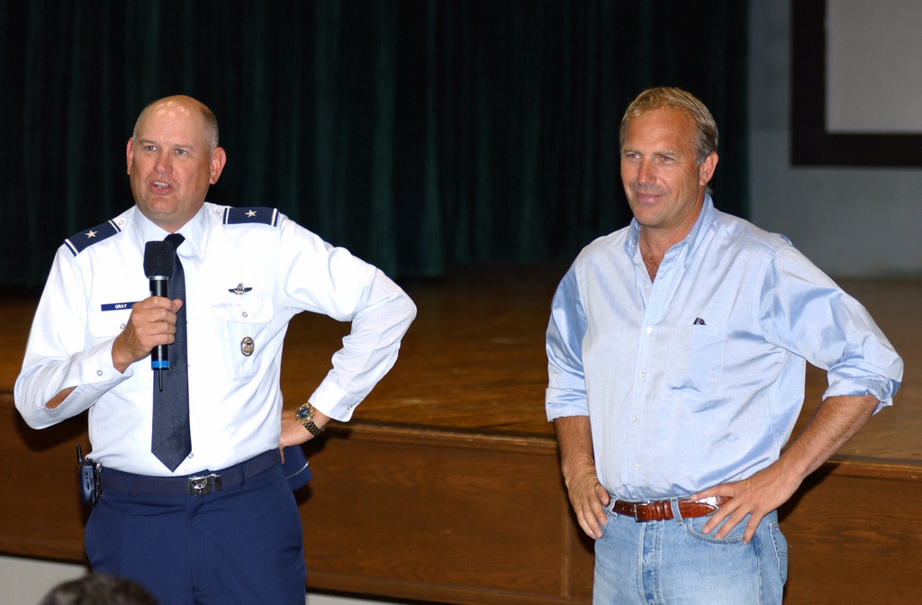 "While visiting Andrews Air Force Base (AFB), for the prescreening of his film, ""Open Range"", actor and director Kevin Costner, is introduced to the viewing US Air Force (USAF) personnel by Brigadier General (BGEN) David S. ""Scott"" Gray"