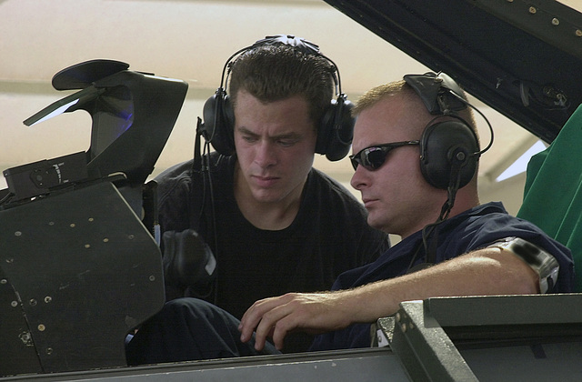 US Air Force (USAF) SENIOR AIRMAN (SRA) Robert Kuhn, left, a specialist and STAFF Sergeant (SSGT) Wayne Wood, a dedicated Crew CHIEF, both in the 31st Aircraft Maintenance Squadron (AMXS), perform a pre-flight operational check on an F-16 Fighting Falcon fighter during an Air War and Red Flag training exercise at Nellis Air Force Base (AFB), Nevada (NV)