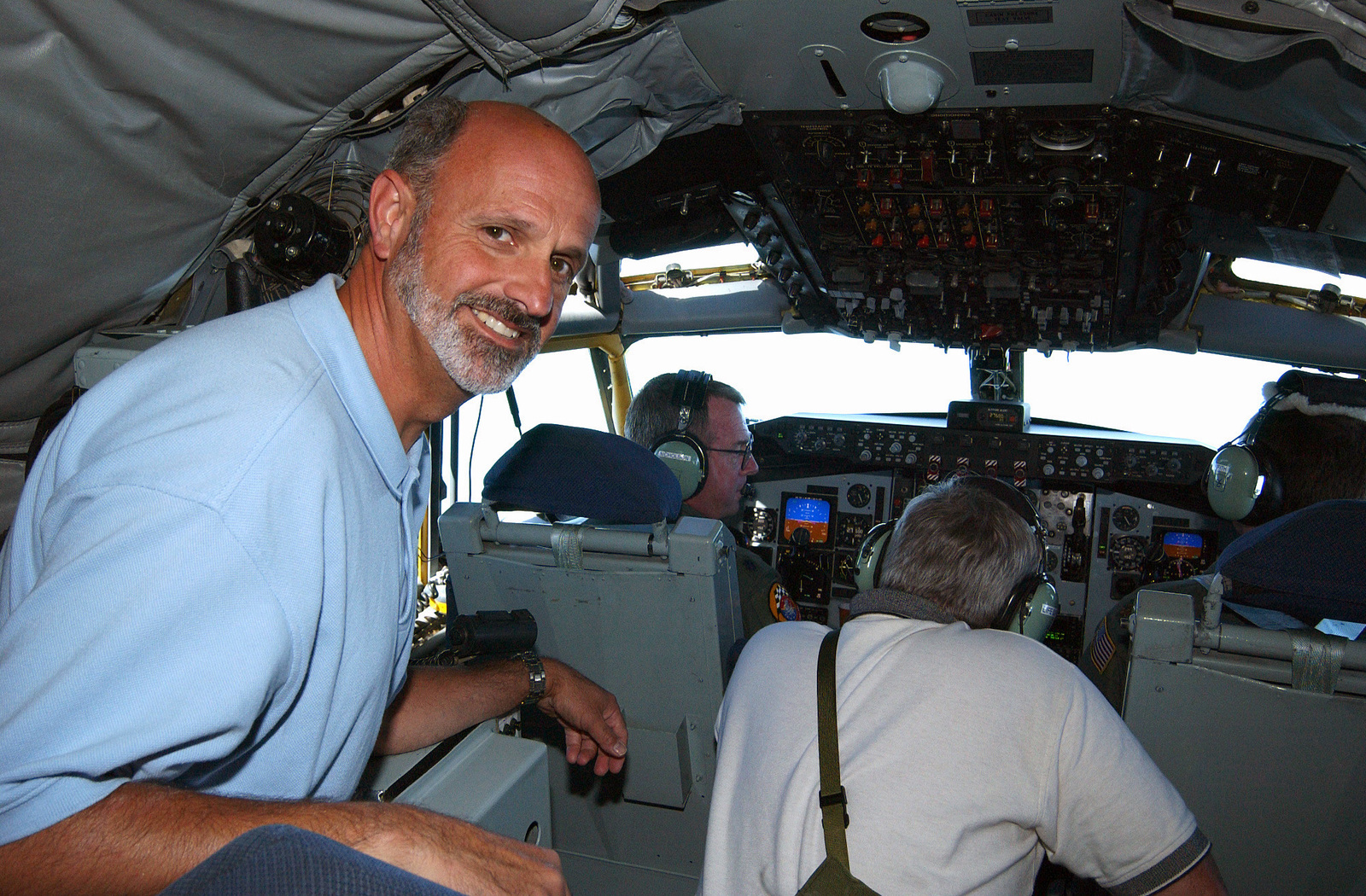 Karl Oskoian of General Dynamics enjoys his flight in the cockpit of a KC 135 Statotanker during a refueling mission in support of the US Air Force (USAF) Thunderbirds during the 2003 Selfridge Air Show in Michigan (MI)