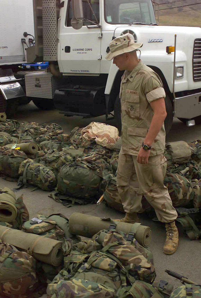 US Marine Corps (USMC) Corporal (CPL) Aaron Boerger, assigned to Echo/ Battery, 2nd Battalion, 11th Marine Regiment, looks for his pack at Marine Corps Base (MCB) Camp Pendleton, California (CA). CPL Boerger is returning home following a deployment in support of Operation IRAQI FREEDOM