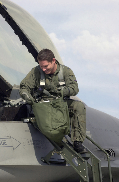 US Air Force (USAF) First Lieutenant (1LT) Skylar Hester, a pilot for the 510th Fighter Squadron (FS), performs pre-flight checks on his F-16 Fighting Falcon fighter during an Air Warrior training exercise at Nellis Air Force Base (AFB), Nevada (NV)