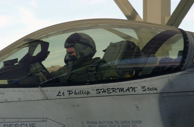US Air Force (USAF) First Lieutenant (1LT) Skylar Hester, a pilot for the 510th Fighter Squadron (FS), performs pre-flight inspection during an Air Warrior training exercise held at Nellis Air Force Base (AFB), Nevada (NV)