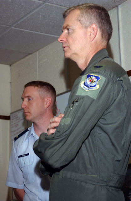 US Air Force (USAF) Colonel (COL) Guy Walsh, right, Commander of the 175th Wing, Maryland Air National Guard (ANG), visits Second Lieutenant (2LT) Rusty Clark and fellow members of the 100th Communications Squadron (CS), on his arrival at Royal Air Force (RAF) Mildenhall, England (ENG)
