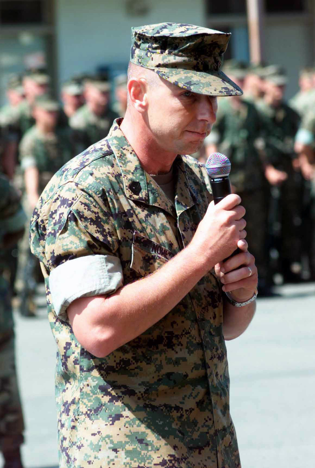 US Marine Corps (USMC) First Sergeant (1SGT) Bryan S. Nohl, 1ST Light Armored Reconnaissance Battalion (1ST LAR), Marine Corps Base (MCB) Camp Pendleton, California (CA), addresses the audience after accepting command during the Sergeant Major Relief and Appointment Ceremony on the 1ST LAR parade deck