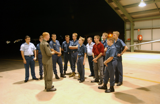 From Iwakuni, Japan, US Marine Corps (USMC) Major (MAJ) Brent Trouslot, Department Safety Officer (DSO), briefs visiting Royal Australian Air Force (RAAF) cadets about his duties in the Vertical Marine Fighter Attack Squadron (VMFA-212) while deployed to Exercise SOUTHERN FRONTIER 2003, at the Royal Australian Air Force RAAF Base Darwin, Australia