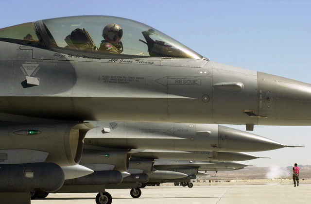 US Air Force (USAF) F-16C Fighting Falcon aircraft from the 510th and 555th Fighter Squadrons line up for take-off on the flight line at Nellis Air Force Base (AFB, Nevada (NV) to participate in the AIR WARRIOR and RED FLAG Training Exercises