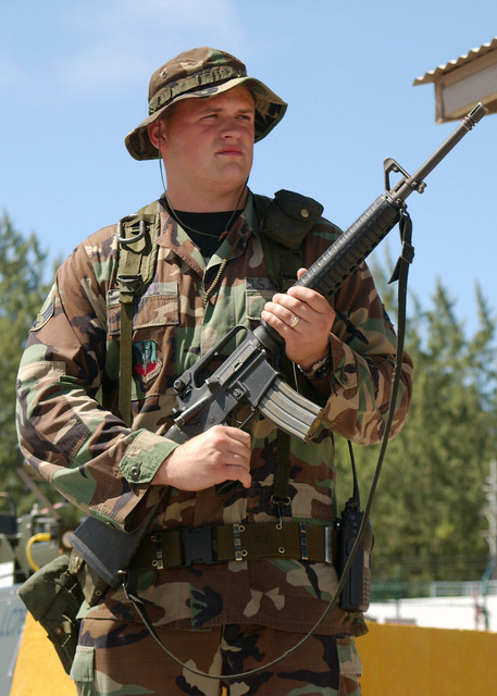 US Air Force (USAF) SENIOR AIRMAN (SRA) John Foster, assigned to the Security Forces Squadron (SFS), stands guard at the entrance to the flight line armed with a 5.56mm M16A2 rifle, at an undisclosed forward operating location