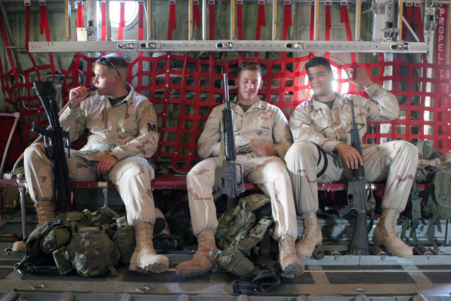 US Marine Corps (USMC) Lance Corporal (LCPL) Scott Bishop (left), USMC CPL Jeremy Willett (center), and USMC Sergeant (SGT) Donald Malagon (right), all are Military Police (MP) with Marine Wing Support Squadron-373 (MWSS), aboard a USMC KC-130 Hercules, Marine Aerial Refueler Transport Squadron-234 (VMGR). The three are armed with 5.56 mm M16A2 rifles. The US Marines are currently deployed to Kuwait and Iraq in support of Operation ENDURING FREEDOM and IRAQI FREEDOM