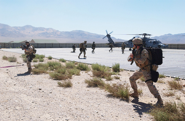 US Navy (USN) SEAL Team Members prepare to board a HH-60F Seahawk helicopter at an extraction point during a Non-Combatant Evacuation Operation (NEO) training exercise conducted during DESERT RESCUE XI. The exercise is the premiere Search And Rescue (SAR) training exercise involving all branches of the US Military and is conducted at the ranges at Fallon Naval Air Station (NAS), Nevada (NV)