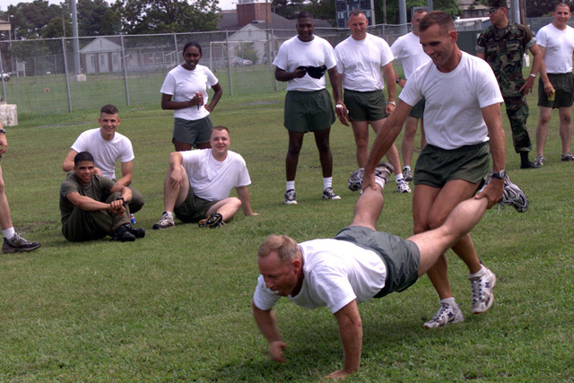 US Marine Corps (USMC) Sergeant Major (SGM) Sekula, is wheel-barreled by Executive Officer (EO), Major (MAJ) Hodges, during a relay race held between Headquarters and Headquarters Squadron (H&HS) and Marines from Marine Wing Headquarters Squadron-2 (MWHS-2) on Marine Corps Air Station (MCAS) Cherry Point, North Carolina