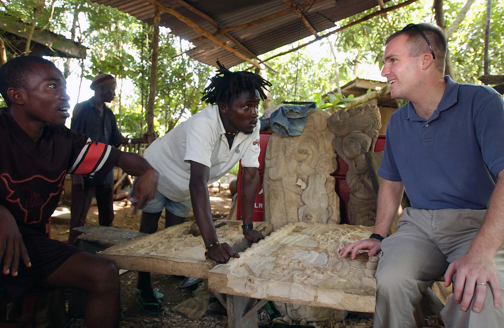US Air Force (USAF) Special Agent (SA) Vance Little, Air Force Office of Special Investigations (AFOSI), speaks with local woodcarvers in Lungi, Sierra Leone, while deployed with the 398th Air Expeditionary Group (AEG), during Joint Task Force (JTF) Liberia