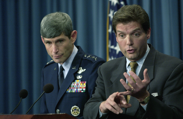 US Acting Assistant Secretary of Defense for Public Affairs, The Honorable Lawrence Di Rita (foreground) responds to a reporter's question during a Pentagon press briefing. Assistant Secretary Di Rita and US Air Force (USAF) Lieutenant General (LGEN) Norton Schwartz, Director for Operations, J-3, Joint STAFF, briefed reporters on the coalition's progress in Iraq