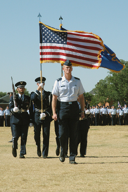 US Air Force (USAF) Colonel (COL) Faulkner, leads the 90th Space Wing's Color Guard, during Wings Change of Command and Pass and Review Ceremony, held at Francis E. Warren Air Force Base (AFB), Wyoming (WY)