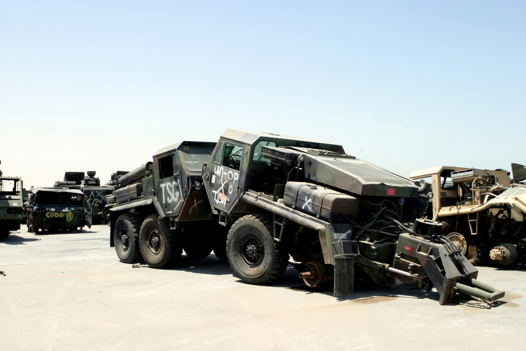 US Marine Corps (USMC) MK48 Front Power Units for the Logistics Vehicle System (LVS) damaged during Operation IRAQI FREEDOM ready for loading onto a Maritime Prepositioning Ship (MPS) at Mohammed Al Ahmed Naval Base, Kuwait. US Marines deployed to Southwest Asia in support of Operations ENDURING FREEDOM and IRAQI FREEDOM