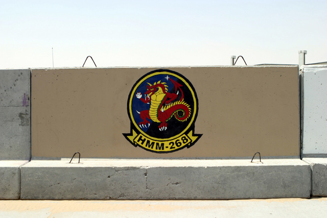 US Marine Corps (USMC) Marines from Marine Medium Helicopter Squadron-268 (HMM-268), Marine Air Group-39 (MAG-39) painted a mural on a road barricade at Ali Al Salem Air Base (AB), Kuwait. US Marines deployed to Southwest Asia in support of Operations ENDURING FREEDOM and IRAQI FREEDOM