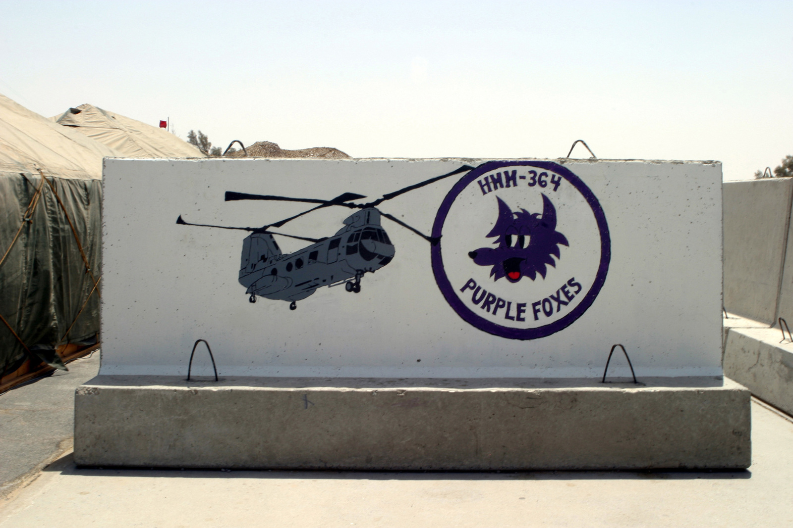 US Marine Corps (USMC) Marines from Marine Medium Helicopter Squadron-364 (HMM-364), Marine Air Group-39 (MAG-39), painted a mural on a road barricade at Ali Al Salem Air Base (AB), Kuwait. US Marines deployed to Southwest Asia in support of Operations ENDURING FREEDOM and IRAQI FREEDOM