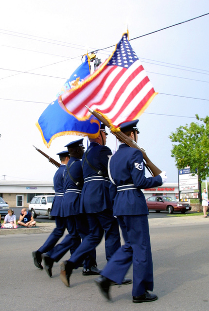 A US Air Force (USAF) Color Guard participates in a parade honoring local New York State military members, held along Military Road in Niagara Falls, New York (NY)