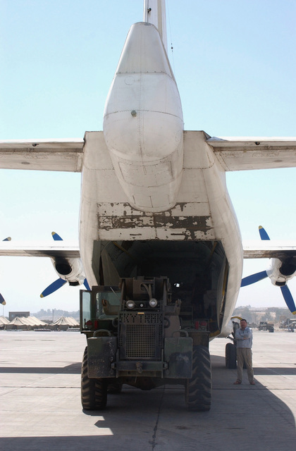 US Army (USA) Soldiers assigned to the 101st Airborne Division (Air Assault) unload a shipment of mail from DHL An-12 Cub commercial aircraft at the Al Mosul Airport in Mosul, Iraq, during Operation IRAQI FREEDOM