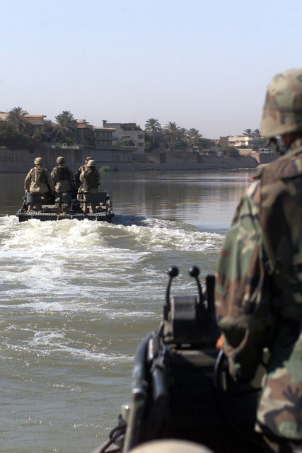 US Army (USA) Soldiers assigned to the 671st Engineer Company, use Mk-2 patrol boats to conduct patrols along the Tigris River in Baghdad, Iraq, during Operation IRAQI FREEDOM