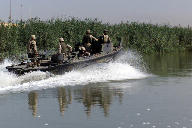 US Army (USA) Soldiers assigned to the 671st Engineer Company, use Mk-2 patrol boat to conduct patrols along the Tigris River in Baghdad, Iraq, during Operation IRAQI FREEDOM