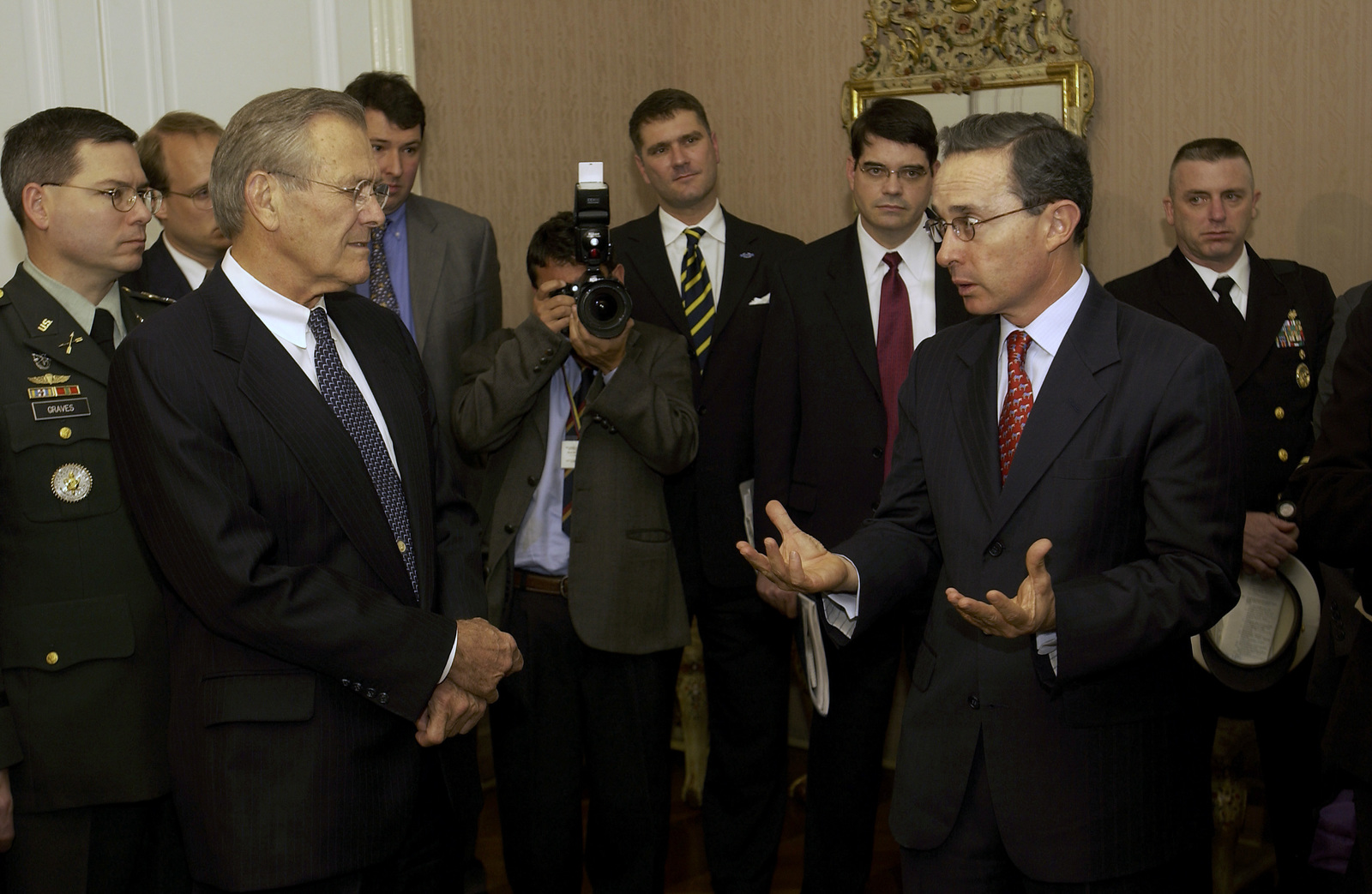 The Honorable Donald H. Rumsfeld, (left) U.S. Secretary of Defense, listens while Colombian President Alvaro Uribe, right, responds to a reporter's question during his visit at the Palacio Narino, Bagot, Colombia, on Aug. 19, 2003. (DoD photo by TECH. SGT. Andy Dunaway) (Released)
