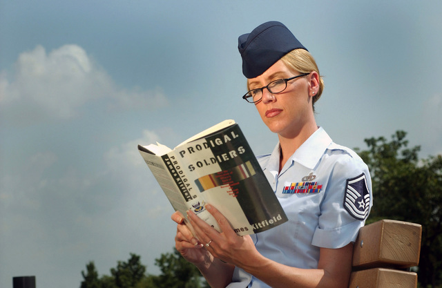 US Air Force (USAF) MASTER Sergeant (MSGT) Christine Adamick, a Vocalist and Tour Manager for the USAF Band, invests time to read and relax on the waterfront at Bolling Air Force Base (AFB), Washington, District of Columbia (DC), with a copy of the book Prodigal Soldier, written by James Kitfield, one of 14 books chosen for the current Air Force CHIEF of STAFF (CSAF) Professional Reading Program