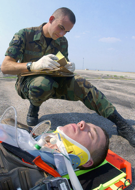 US Air Force (USAF) AIRMAN First Class (A1C) Jason Blackford, 28th Medical Operations Squadron (MDOS), 28th Bomb Wing, records vital information on an accident victim during a Major Accident Response Exercise (MARE), during Phase I of the base wide pre-deployment preparation for the Air Combat Commands (ACC) upcoming Operational Readiness Inspection (ORI), at Ellsworth Air Force Base (AFB), South Dakota (DK)
