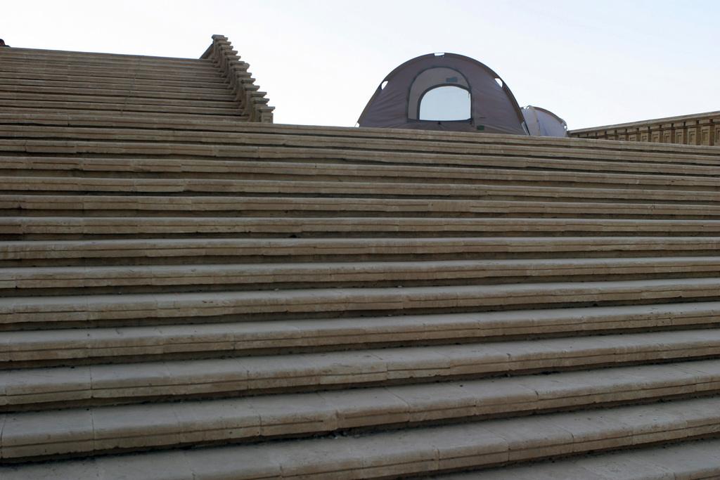 A Marine Infantry Shelter sits atop the steps outside a palace formerly owned by Saddam Hussein, at Camp Babylon, Iraq, during Operation IRAQI FREEDOM