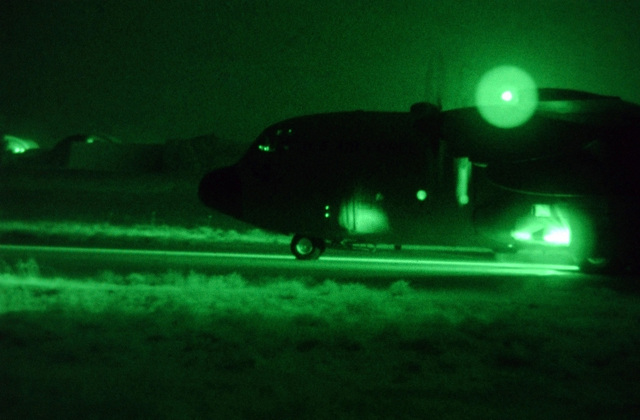 Light enhanced photography showing a US Air Force (USAF) C-130 Hercules aircraft awaiting clearance for departure on the runway at Kirkuk AB in Northern Iraq, during Operation IRAQI FREEDOM. Twenty injured Airmen and Soldiers were airlifted from the base making this the largest medical evacuation mission as of date