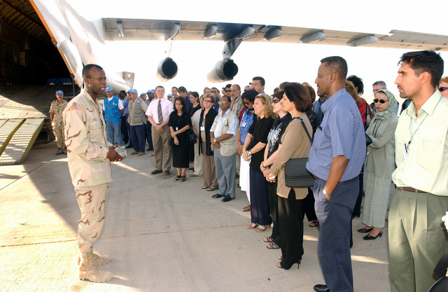 Major (MAJ) William Green, USA, Chaplain, speaks to a gathering of co-worker, and friends during a Memorial Service held for the bombing victims from the United Nations Office of Humanitarian Coordinator for Iraq (UNOHCI), as the arrive at Baghdad International Airport, Iraq, during Operation IRAQI FREEDOM. The bombing victims remains will be airlifted to their respective home countries for repatriation