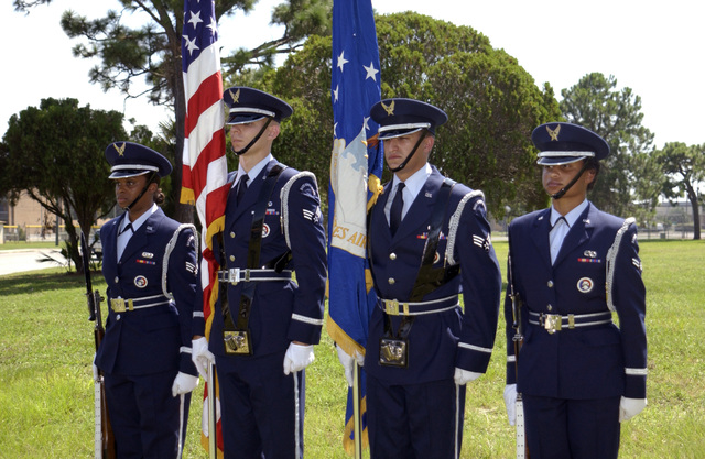 Members of the US Air Force (USAF) Base Honor Guard Team form Tyndall Air Force Base (AFB) Florida (FL), conduct practices for color guard duty. Pictured left-to-right are SENIOR AIRMAN (SRA) Jessica Dennard, SRA Michael Avery, SRA William Goolsby, and AIRMAN First Class (A1C) Nicole Lindsay