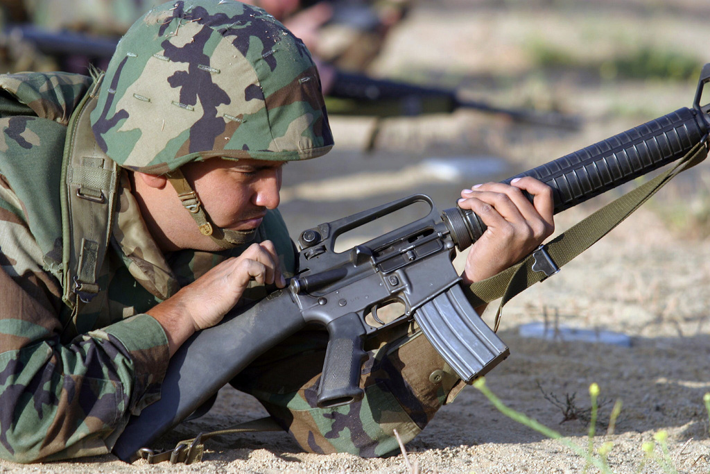 US Marine Corps (USMC) Sergeant (SGT) Joseph Morin, Headquarters Battalion (HQ BN), Marine Corps Base (MCB) Camp Pendleton, California (CA), clear his 5.56 mm M16A2 rifle after shooting in the prone position at Wilcox Range Located at 33 Area on the camp